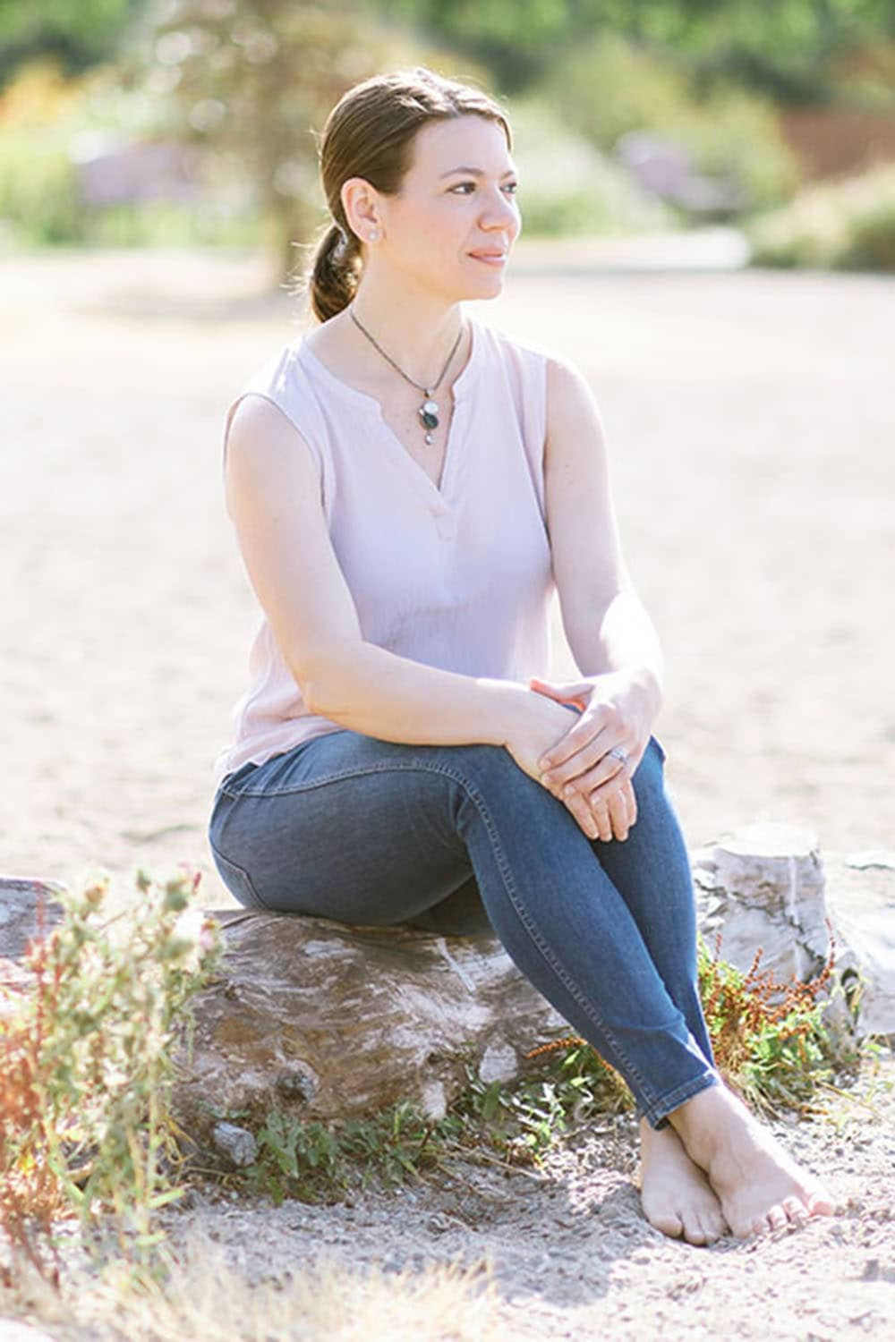 Laura sitting on a rock