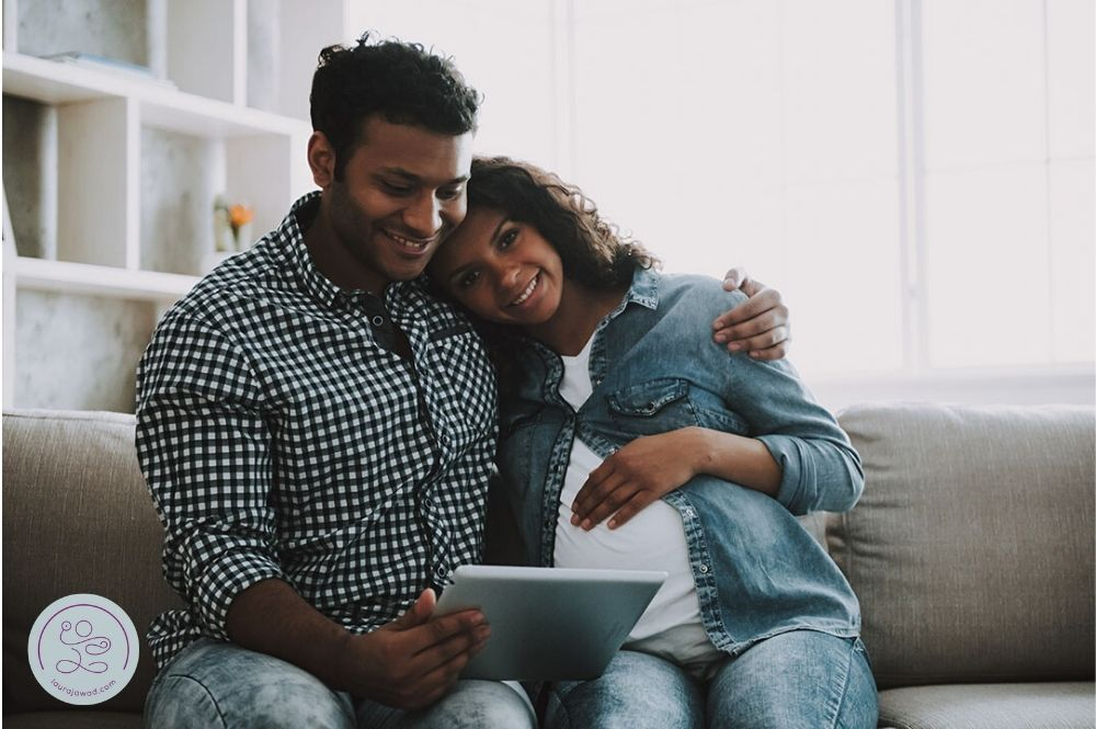 Indian couple researching birth support options in Seattle
