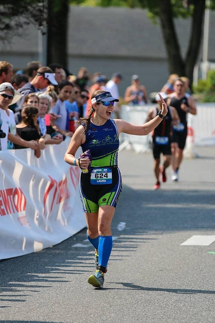Postpartum triathlete finishing a half-ironman