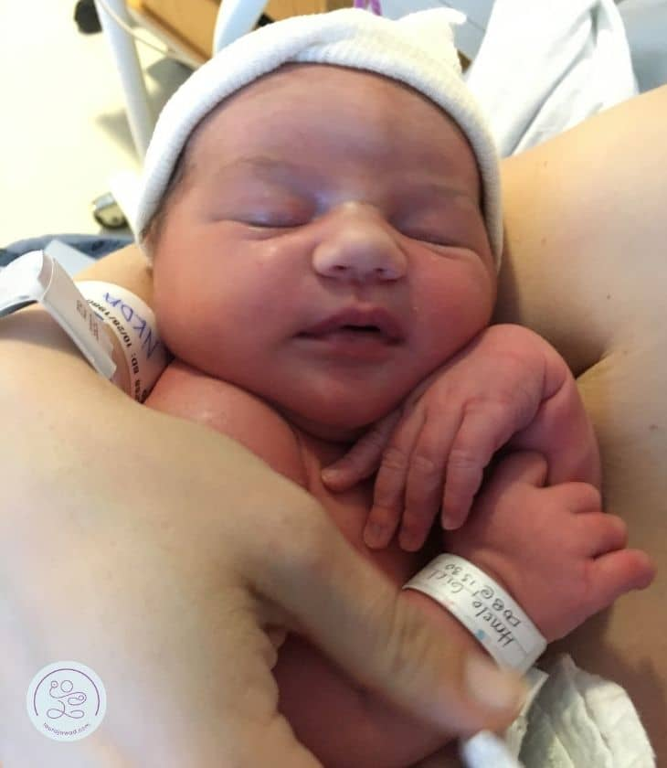 Laura holding newborn daughter.